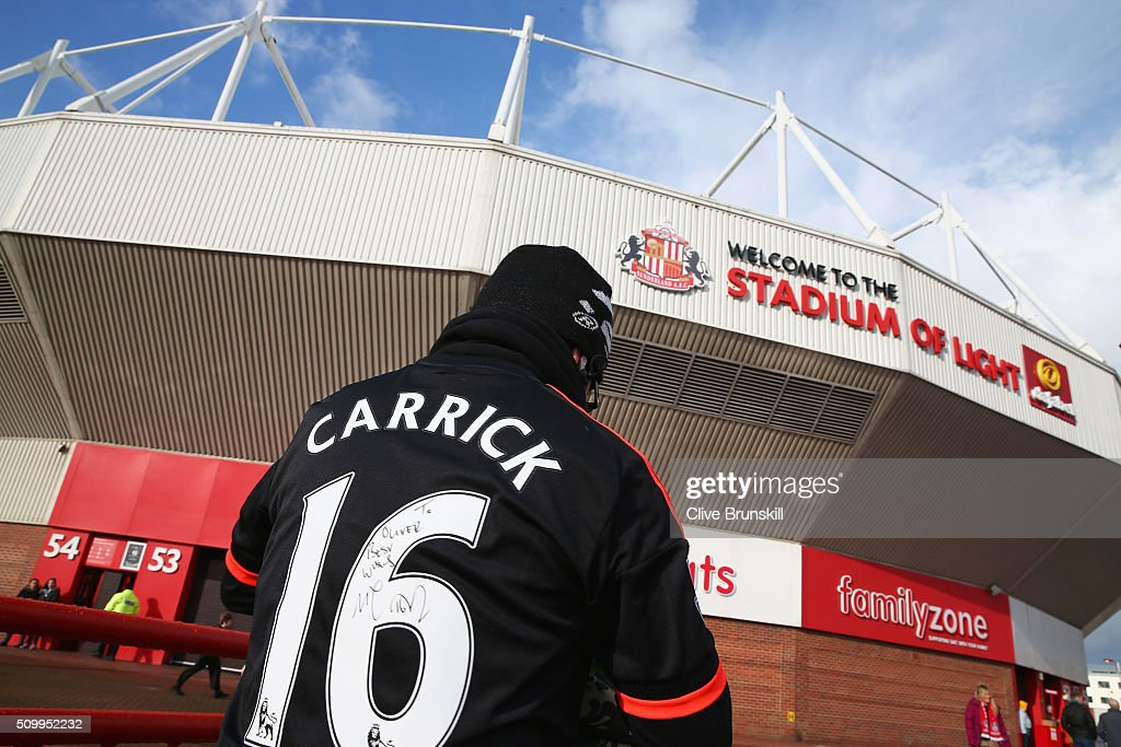 A Manchester United supporter arrives at the stadium prior to the Barclays Premier League match between Sunderland and Manchester United at the Stadium of Light on February 13, 2016 in Sunderland, England.