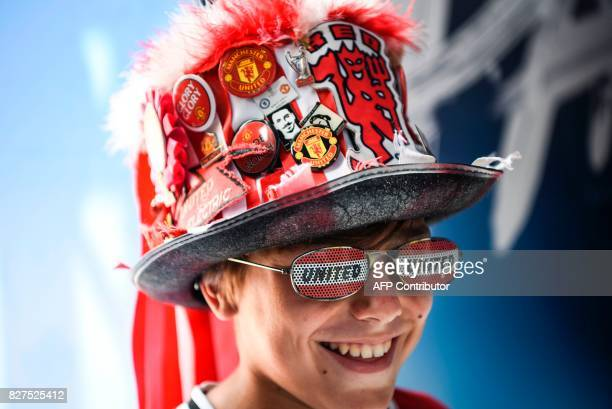 Manchester United supporter smiles in the fan zone in Skopje on August 8 2017 ahead of the UEFA Super Cup football match between Real Madrid and...