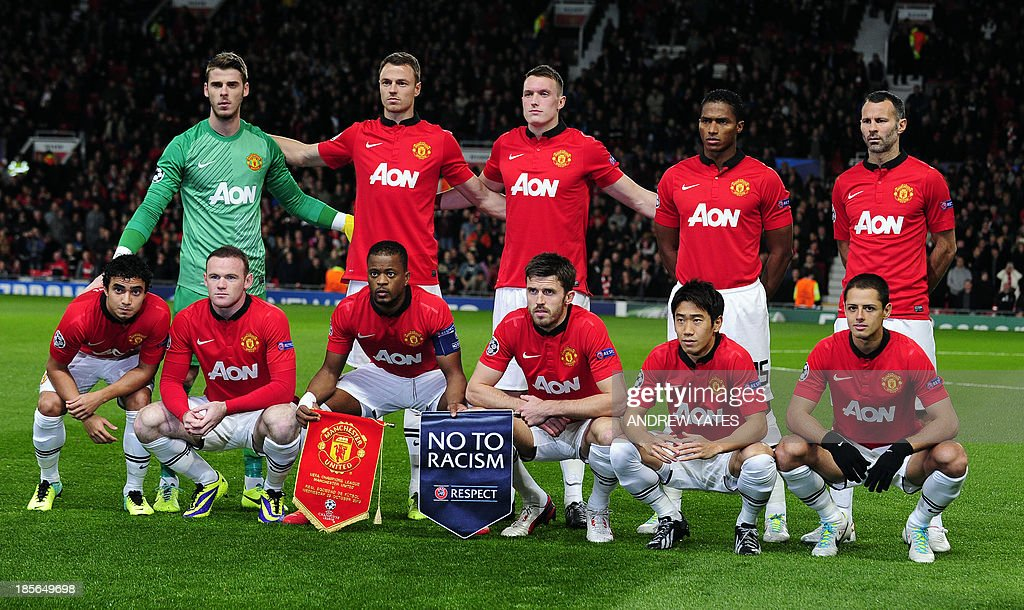 Manchester United team (L-R up) Manchester United's Spanish goalkeeper David de Gea, Manchester United's Northern Irish defender Jonny Evans, Manchester United's English defender Phil Jones, Manchester United's Ecuadorian midfielder Antonio Valencia, Manchester United's Welsh midfielder Ryan Giggs, (L-R lower) Manchester United's Brazilian defender Rafael, Manchester United's English striker Wayne Rooney, Manchester United's French defender Patrice Evra, Manchester United's English midfielder Michael Carrick, Manchester United's Japanese midfielder Shinji Kagawa and Manchester United's Mexican striker Javier Hernandez line up ahead of the UEFA Champions League football match between Manchester United and Real Sociedad at Old Trafford in Manchester, north west England on October 23, 2013.