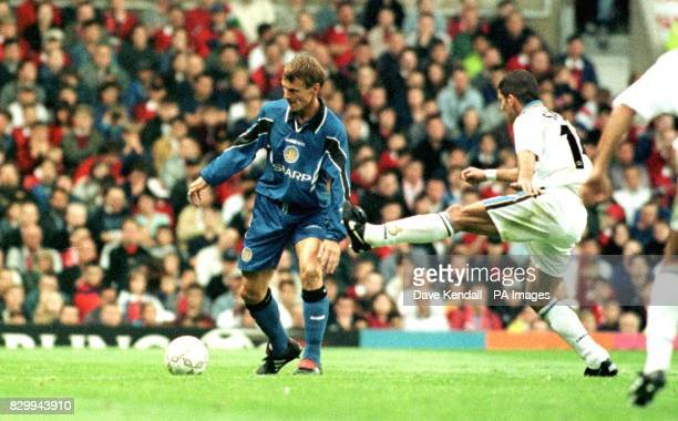 United new signing Teddy Sheringham evades Inter's Diego Simeone during tonights friendly at Old Trafford PA Photo by Dave Kendall/PA