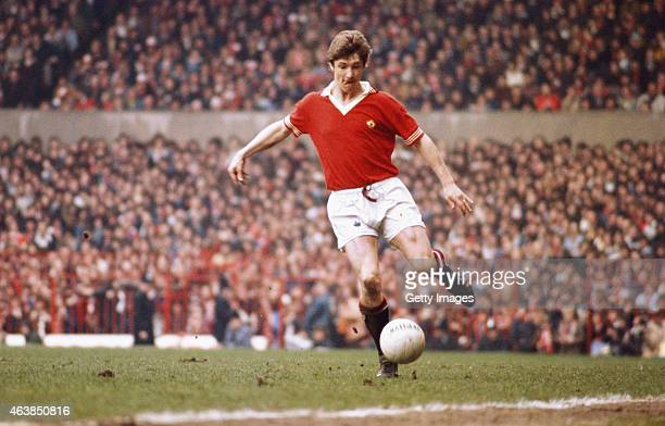 Manchester United winger Gordon Hill in action during a match between Manchester United and Everton at Old Trafford on April 17 1976 in Manchester...