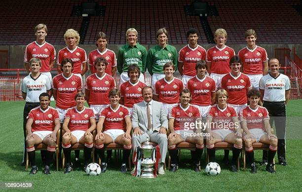 Manchester United with the FA Cup at Old Trafford Manchester August 1983 Back row left to right Gordon McQueen Scott McGarvey Mike Duxbury Gary...