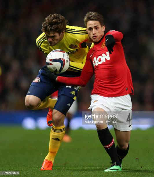 Manchester United's Adnan Januzaj and Sunderland's Marcus Alonso battle for the ball