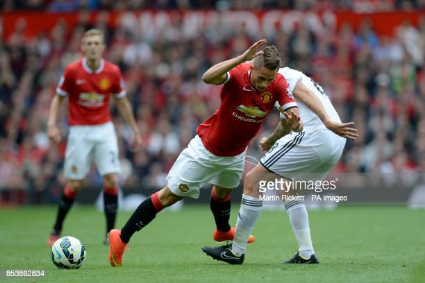 Manchester United's Adnan Januzaj and Swansea City's Jonjo Shelvey battle for the ball during the Barclays Premier League match at Old Trafford...