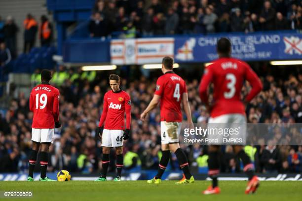 Manchester United's Adnan Januzaj and team mates stand dejected after conceding their first goal