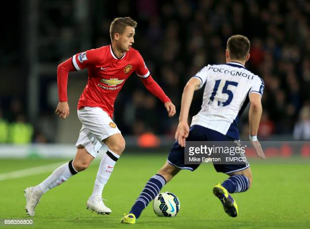 Manchester United's Adnan Januzaj and West Bromwich Albion's Sebastien Pocognoli battle for the ball
