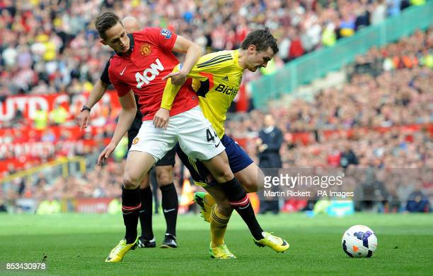 Manchester United's Adnan Januzaj battles for the ball with Sunderland's Adam Johnson during the Barclays Premier League match at Old Trafford...