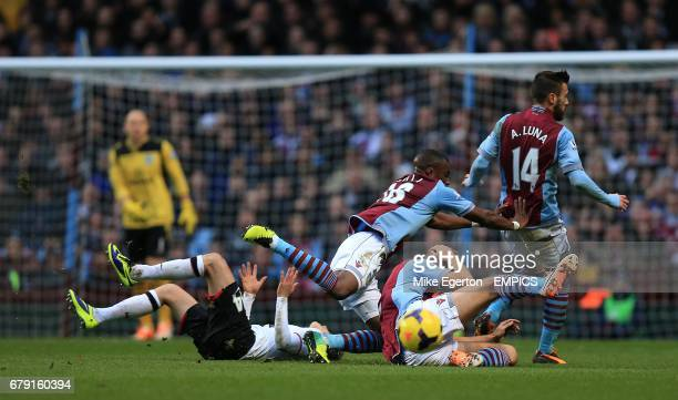 Manchester United's Adnan Januzaj goes down under the challenge from Aston Villa's Yacouba Sylla