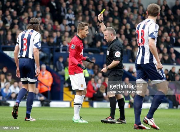 Manchester United's Adnan Januzaj is booked by match referee Jon Moss