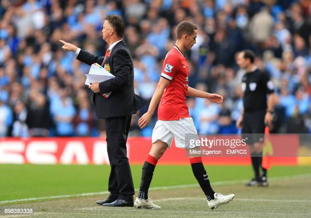Manchester United's Adnan Januzaj looks dejected as he passes manager Louis van Gaal after being substituted