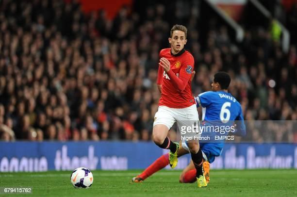 Manchester United's Adnan Januzaj skips past Hull City's Curtis Davies