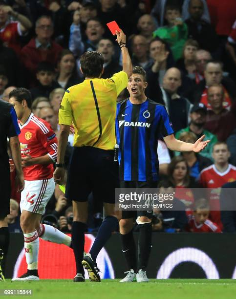 Manchester United's and Club Brugge's Brandon Mechele is shown a red card by referee Deniz Aytekin