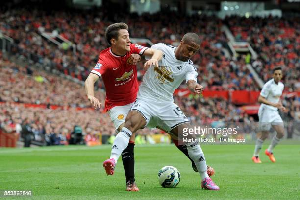 Manchester United's Ander Herrera and Swansea City's Wayne Routledge battle for the ball during the Barclays Premier League match at Old Trafford...