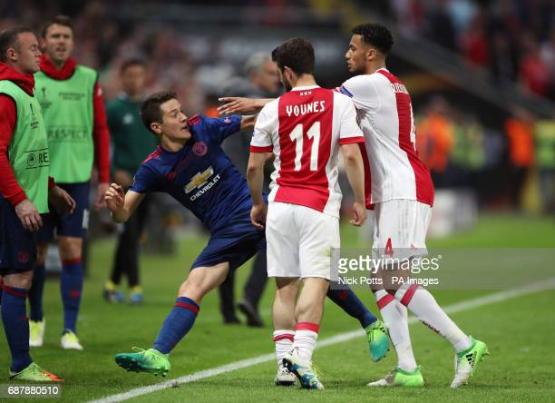 Manchester United's Ander Herrera clashes with Ajax's Amin Younes and Jairo Riedewald during the UEFA Europa League Final at the Friends Arena in...