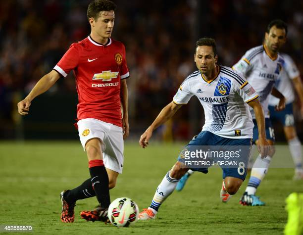 Manchester United's Ander Herrera passes under pressure fromMarcelo Sarvas of the LA Galaxy during their Chevrolet Cup match at the Rose Bowl in...