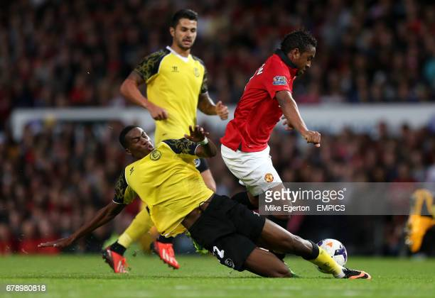 Manchester United's Anderson and Sevilla's Geoffrey Kondogbia battle for the ball