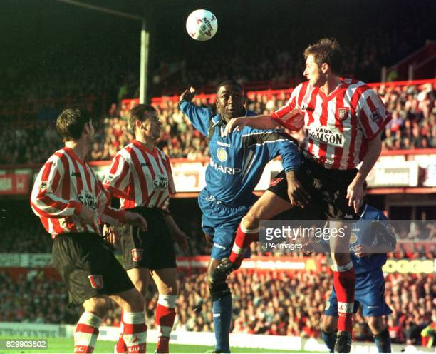 Manchester United's Andy Cole tries a last minute header as Sunderland lead 21 but is put off by Sunderland's David Kelly at Roker Park this...