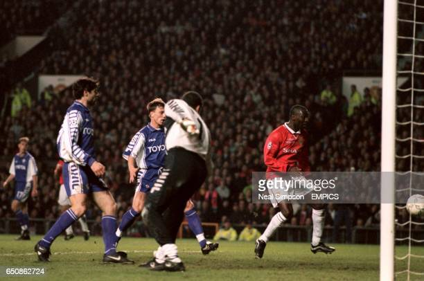 Manchester United's Andy Cole watches Dwight Yorke's header go into the net for the third goal as Fiorentina's Daniele Adani Jorg Heinrich and...