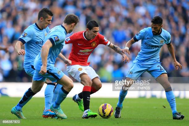 Manchester United's Angel Di Maria in action with Manchester City's Stevan Jovetic James Milner and Gael Clichy