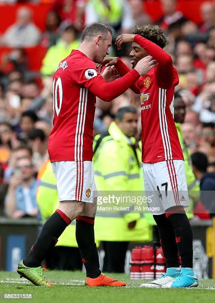 Manchester United's Angel Gomes is substituted on for Manchester United's Wayne Rooney during the Premier League match at Old Trafford Manchester