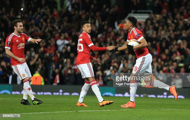 Manchester United's Anthony Martial celebrates scoring his side's first goal of the game against Liverpool with Jesse Lingard