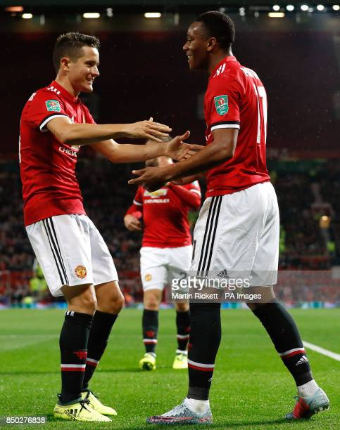 Manchester United's Anthony Martial celebrates scoring his side's fourth goal of the game with team mate Ader Herrera during the Carabao Cup Third...