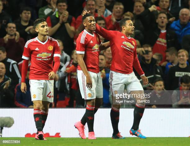 Manchester United's Anthony Martial celebrates scoring his side's third goal of the game against Ipswich Town with Andreas Pereira and Memphis Depay