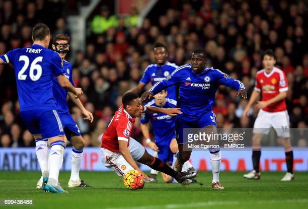 Manchester United's Anthony Martial goes down under pressure from Chelsea's Kurt Zouma