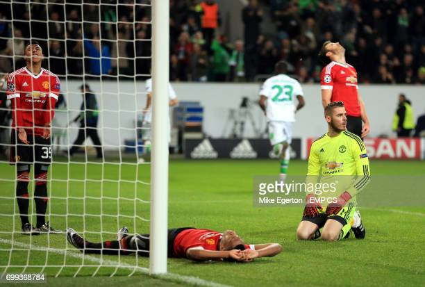 Manchester United's Anthony Martial Michael Carrick Jesse Lingard and goalkeeper David De Gea appear dejected after they concede a third goal