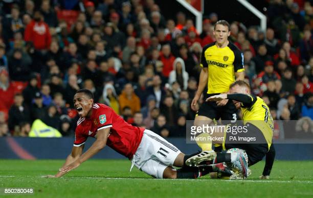 Manchester United's Anthony Martial reacts to a challenge from Burton Albion's Tom Naylor during the Carabao Cup Third Round match at Old Trafford...