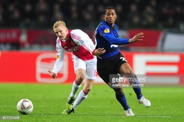 Manchester United's Antonio Valencia and Ajax's Nicolai Boilesen battle for the ball