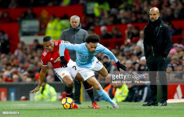 Manchester United's Antonio Valencia and Manchester City's Leroy Sane battle for the ball during the Premier League match at Old Trafford Manchester