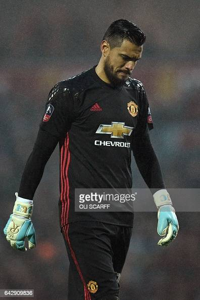 Manchester United's Argentinian goalkeeper Sergio Romero gestures during the English FA Cup fifth round football match between Blackburn Rovers and...