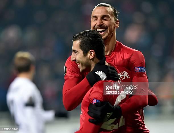 Manchester United's Armenian midfielder Henrikh Mkhitaryan celebrates after scoring a goal with teammate Swedish forward Zlatan Ibrahimovic during...