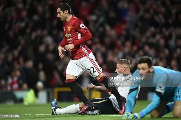 Manchester United's Armenian midfielder Henrikh Mkhitaryan celebrates scoring the opening goal as Tottenham Hotspur's Belgian defender Toby...