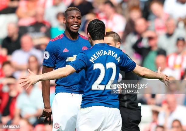 Manchester United's Armenian midfielder Henrikh Mkhitaryan celebrates scoring their second goal with Manchester United's French midfielder Paul Pogba...