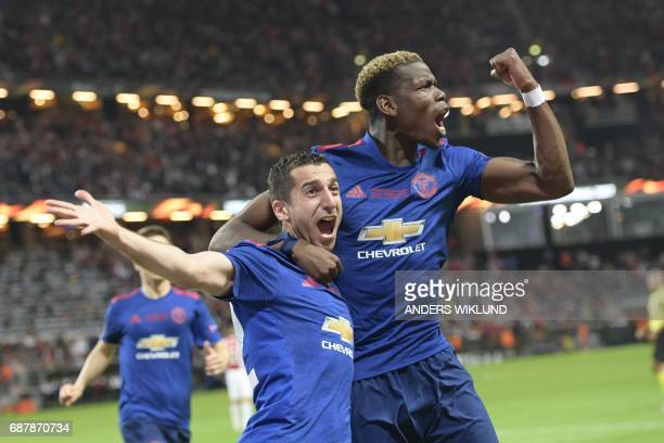 Manchester United's Armenian midfielder Henrikh Mkhitaryan celebrates scoring with Manchester United's French midfielder Paul Pogba during the UEFA...