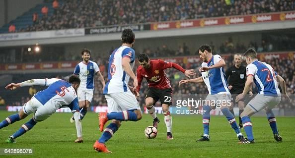 Manchester United's Armenian midfielder Henrikh Mkhitaryan controls the ball during the English FA Cup fifth round football match between Blackburn...