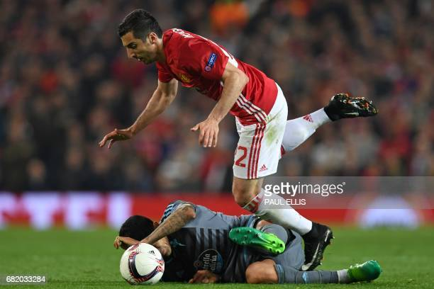 Manchester United's Armenian midfielder Henrikh Mkhitaryan is tackled by Celta Vigo's Chilean midfielder Pedro Pablo Hernandez during the UEFA Europa...