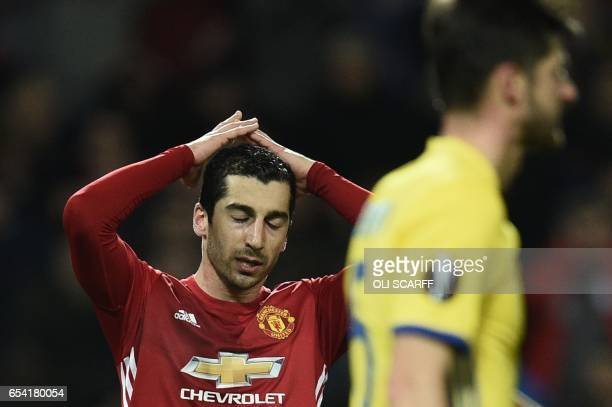 Manchester United's Armenian midfielder Henrikh Mkhitaryan reacts after narrowly missing a chance during the UEFA Europa League round of 16 secondleg...