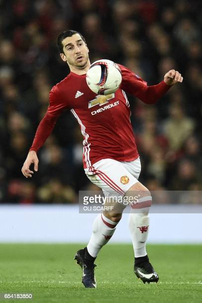 Manchester United's Armenian midfielder Henrikh Mkhitaryan runs with the ball during the UEFA Europa League round of 16 secondleg football match...