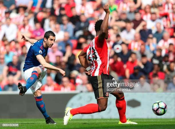 Manchester United's Armenian midfielder Henrikh Mkhitaryan scores their second goal during the English Premier League football match between...