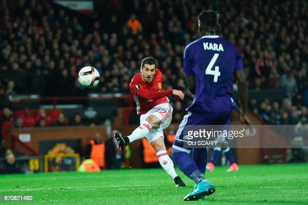 Manchester United's Armenian midfielder Henrikh Mkhitaryan shoots high and wide during the UEFA Europa League quarterfinal second leg football match...