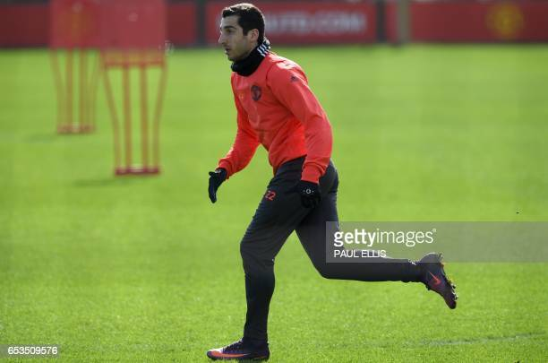 Manchester United's Armenian midfielder Henrikh Mkhitaryan takes part in a training session at their Carrington base in Manchester north west England...