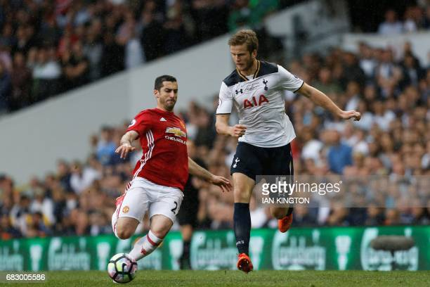 Manchester United's Armenian midfielder Henrikh Mkhitaryan vies with Tottenham Hotspur's English defender Eric Dier during the English Premier League...