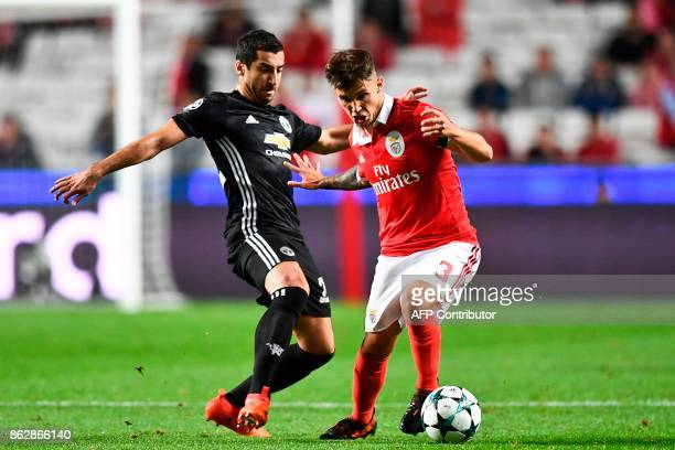 Manchester United's Armenian midfielder Henrikh Mkhitaryan vies with Benfica's Spanish defender Grimaldo Garcia during the UEFA Champions League...
