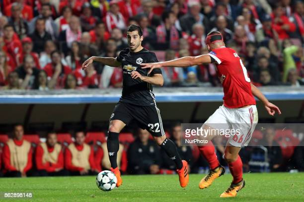 Manchester United's Armenian midfielder Henrikh Mkhitaryan vies with Benfica's Portuguese defender Ruben Dias during the UEFA Champions League...