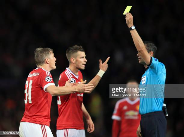 Manchester United's Bastian Schweinsteiger and Morgan Schneiderlin are shown a yellow card by the referee
