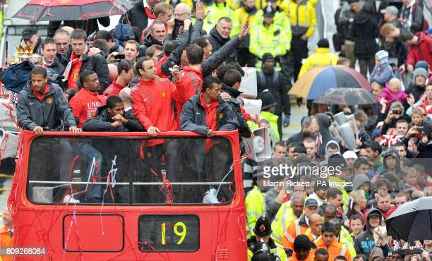 Manchester United's Bebe Patrice Evra Antonio Valencia Dimitar Berbatov Luis Nani and Javier Hernandez stand at the front of the bus during the 2011...