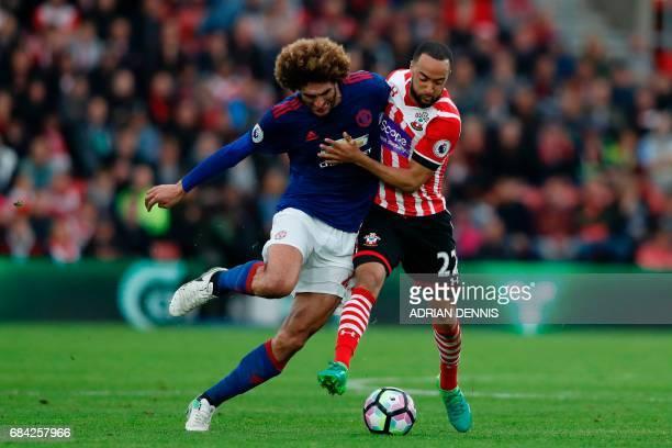 Manchester United's Belgian midfielder Marouane Fellaini battles with Southampton's English midfielder Nathan Redmond during the English Premier...